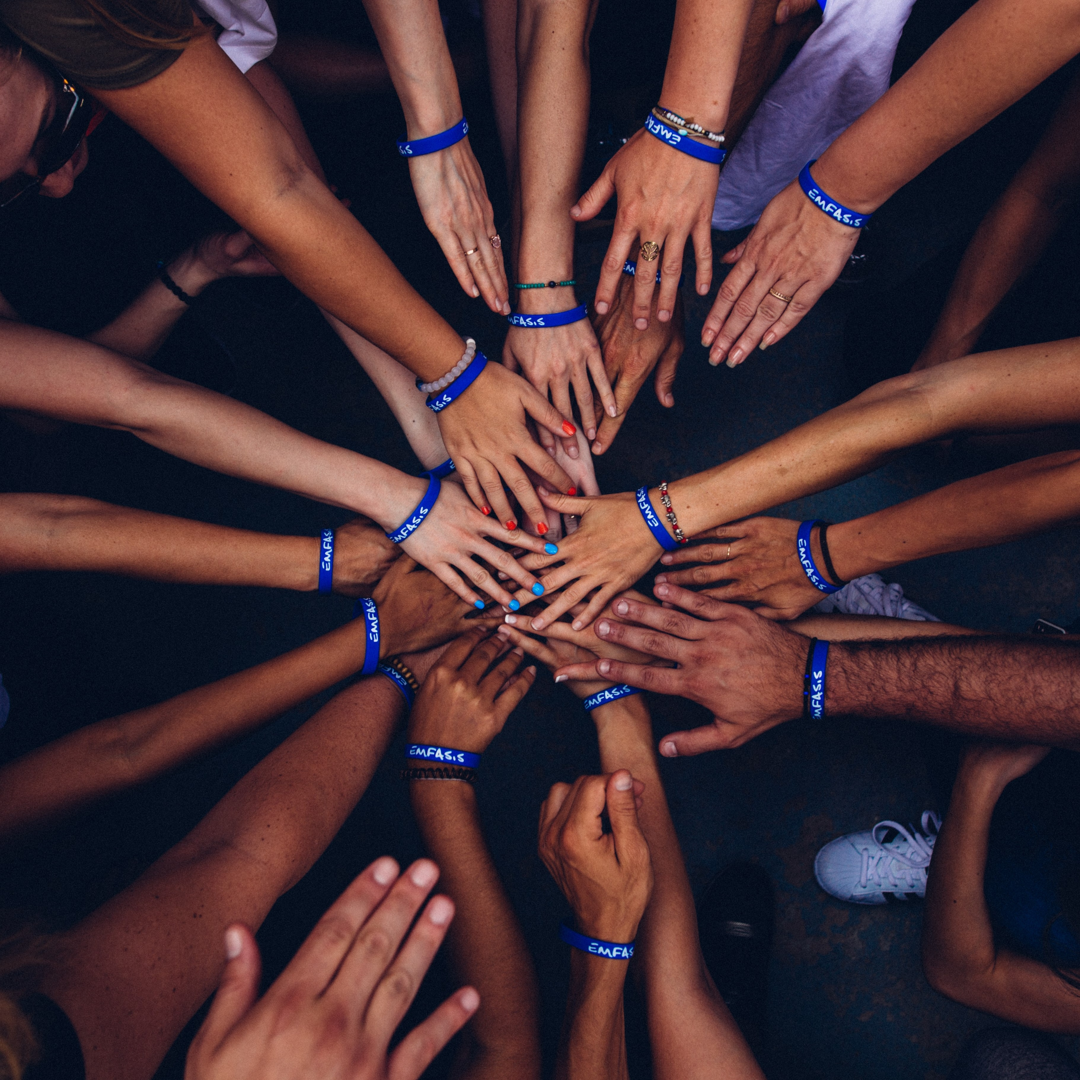 overhead view of hands in a circle