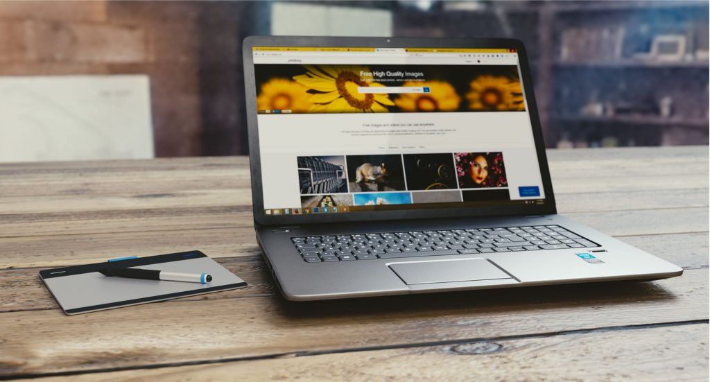 Gray laptop computer open to a website